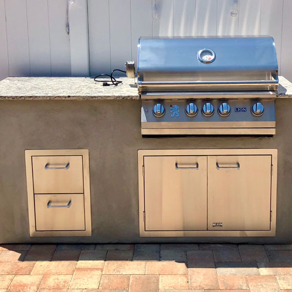 A Lion BBQ island is installed by Forno Nardona for convenient and quality outdoor cooking.