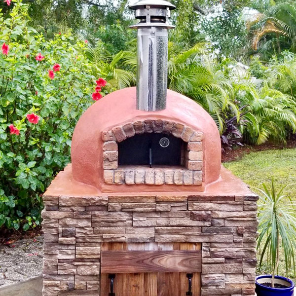 A custom, American-made Nardona Rustico Model brick oven is ready to be used to make delicious pizza!