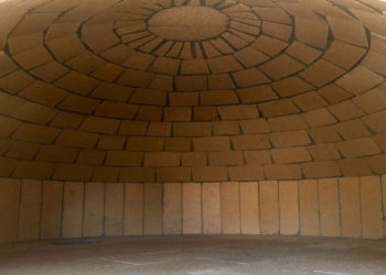 A brick dome in a pizza oven crafted by Forno Nardona.
