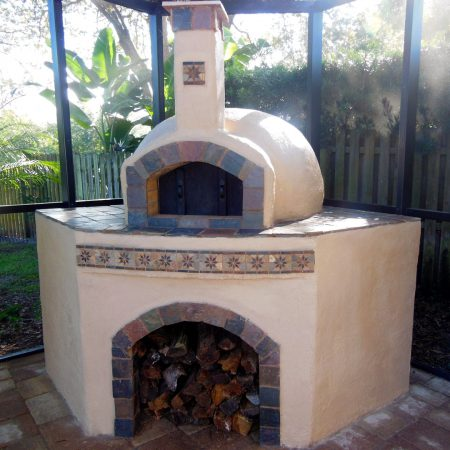 Home pizza oven with custom tile and a cement finish built by Forno Nardona.