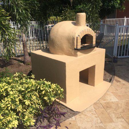 Custom dome pizza oven in Tampa, Florida backyard.