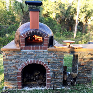 An Italian brick oven hand-crafted by Forno Nardona located in the backyard of a residential home.