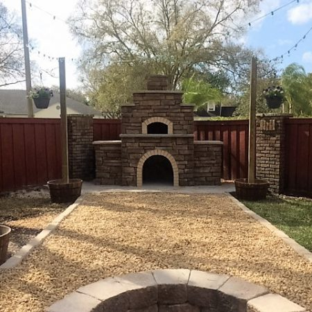 Traditional pizza oven built by Forno Nardona sits as a focal point in the backyard.