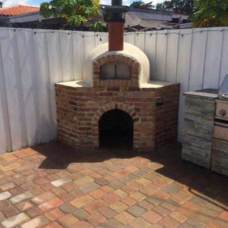A brick pizza oven built by Forno Nardona.