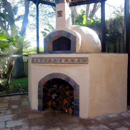 Outdoor wood-fired pizza oven.