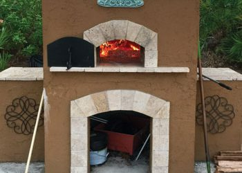 A custom outdoor wood-fired pizza oven