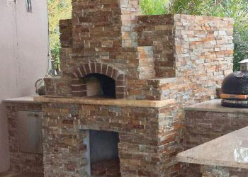 A wood fired pizza oven built into an outdoor kitchen area by Forno Nardona
