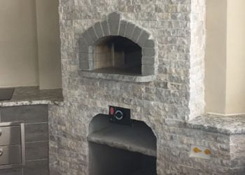 The Firenze model pizza oven built into an outdoor kitchen