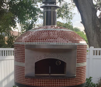 The Napoli model outdoor pizza oven with a glass tile finish