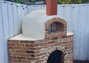 An outdoor brick pizza oven made by Forno Nardona.
