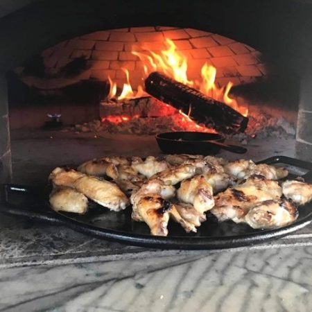 Chicken wings being cooked in a Forno Nardona oven