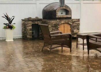 This Forno Nardano copper tiled Rustico outdoor pizza oven creates a welcoming backyard area even in the rain.