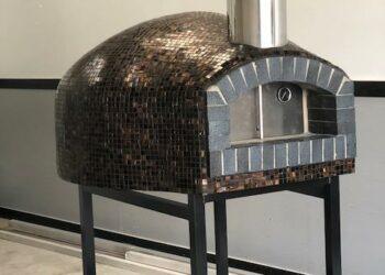 Forno Nardona Rustica custom brick dome pizza oven with back fire brick front on a custom stand.