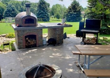 Forno Nardona's traditional pizza oven completes this outdoor kitchen.