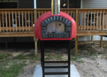 Outdoor pizza oven with red exterior in the Rustico Model