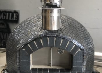 Wood-fired pizza oven with gray glass tiling in the Rustico model built by Forno Nardona