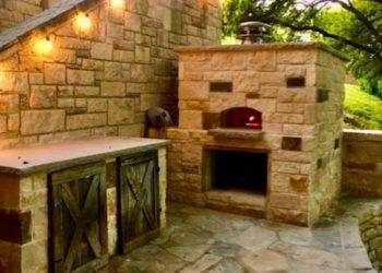 A large, stone outdoor pizza oven