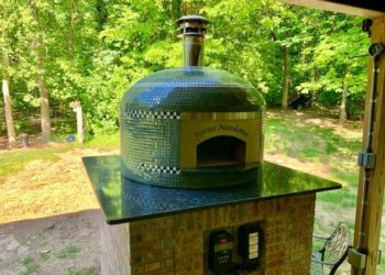 A glass-tiled wood-fired pizza oven for outdoor cooking