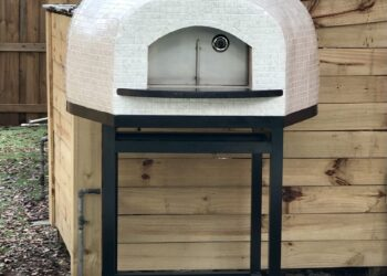 White tiled Forno Nardona Rustico oven on black powder coated stand.